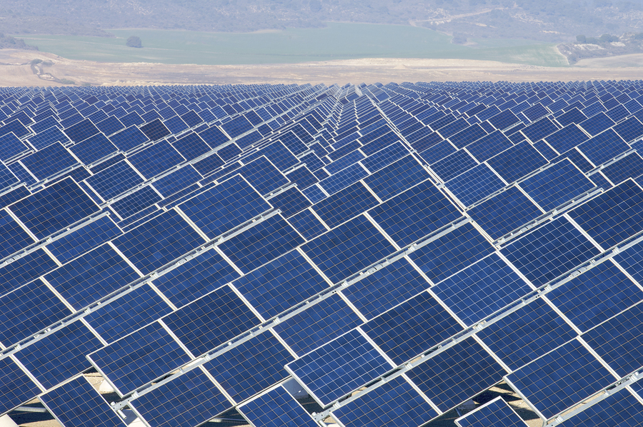 bigstock-huge-solar-field-with-the-back-56728409