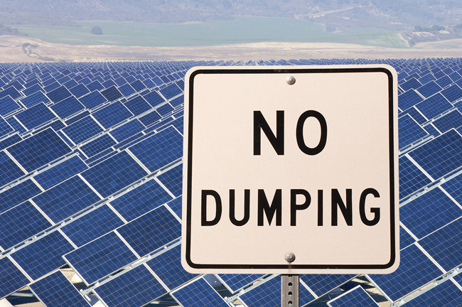 solar panels and a no dumping sign