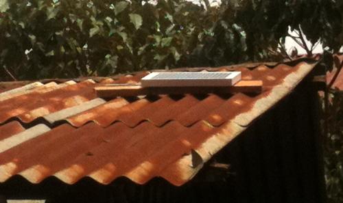 a solar panel on a Kenyan roof